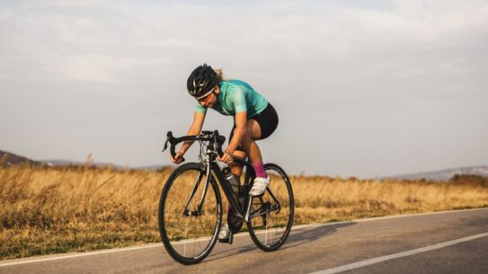 professional female cyclist on the road royalty free image 1594045093